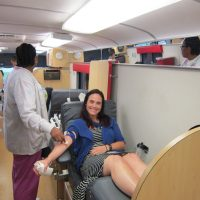 Megan giving blood at blood drive