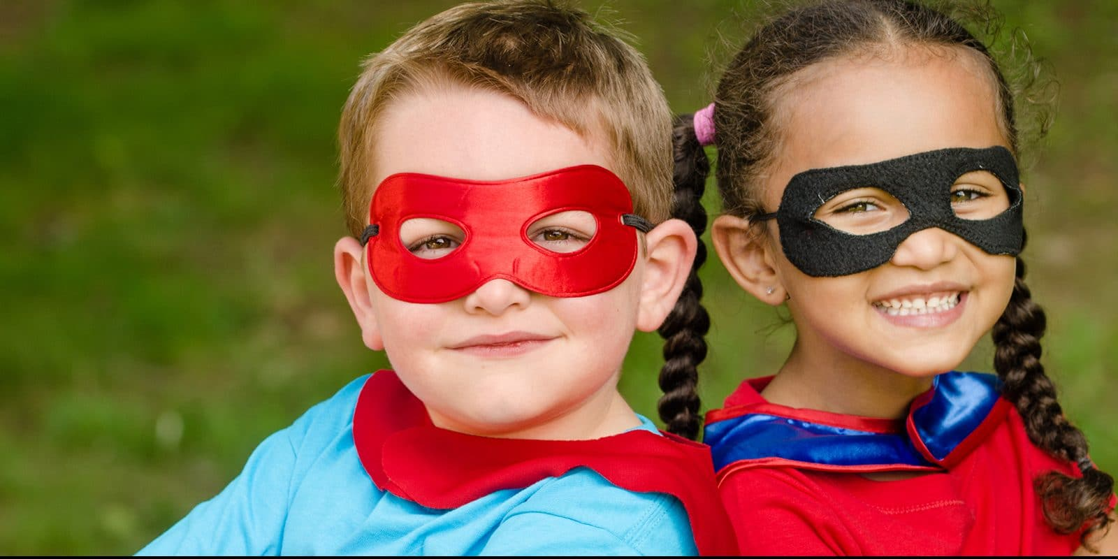 a young boy and girl wearing masks and capes like super heros